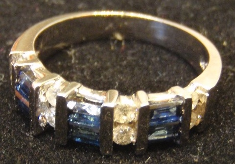 ITEM 008. Beautiful ring, approximately a size 7. Markings indicate 10K-14K, gemstones unknown. (Another view.)