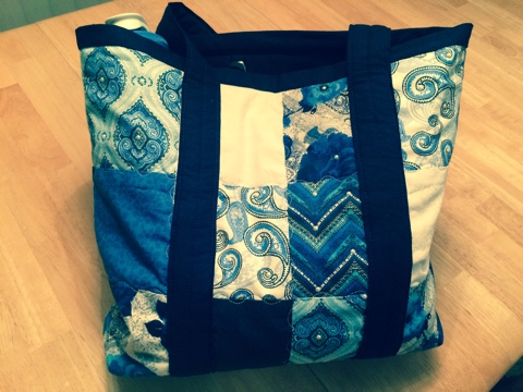"ITEM 012 (view 1 of 2) - Multi-blue and white quilted tote bag with pearl accents made by Barbie Woolley. 15""x13""x4"" with 2 inside pockets plus water bottle holder and magnetic closure."